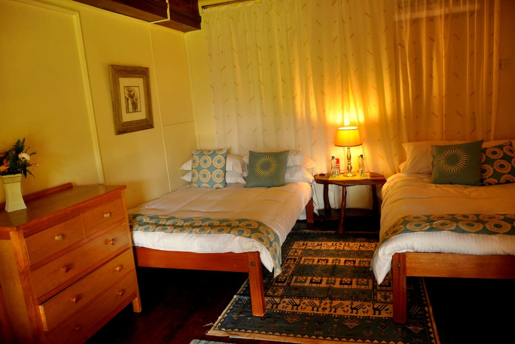 Simba Suite $220 per night Twin suite with both bedroom and sitting room opening onto the verandah