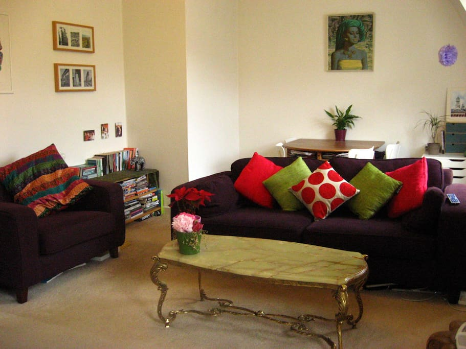 The living room is spacious, with a dining area to the rear of the room