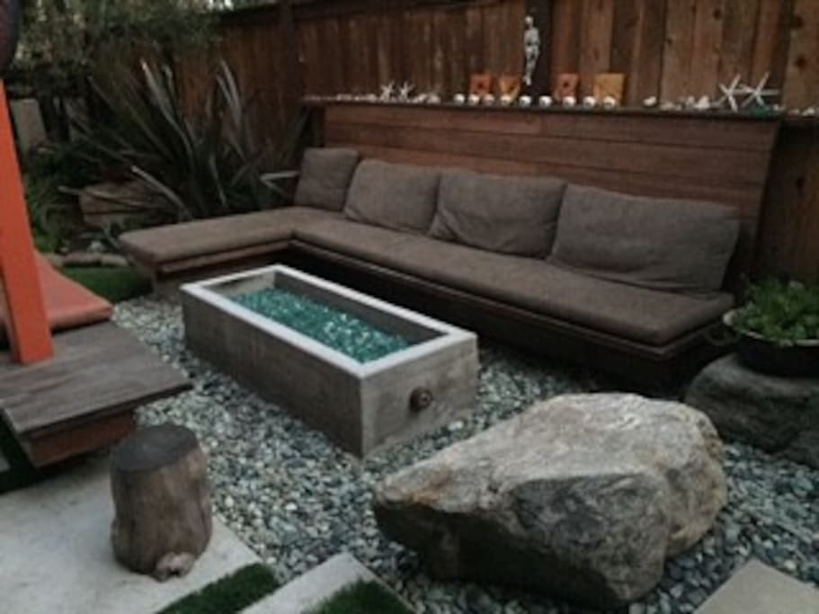 Gorgeous outdoor firepit perfect place for a glass of wine, cocoa, or maybe even breakfast.