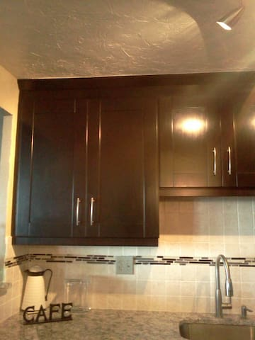 Beautiful cabinetry with crown molding and bottom lighting trim.