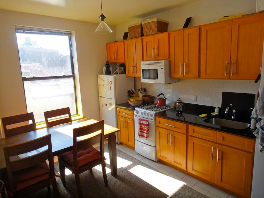 Large and sunny kitchen with a great view.