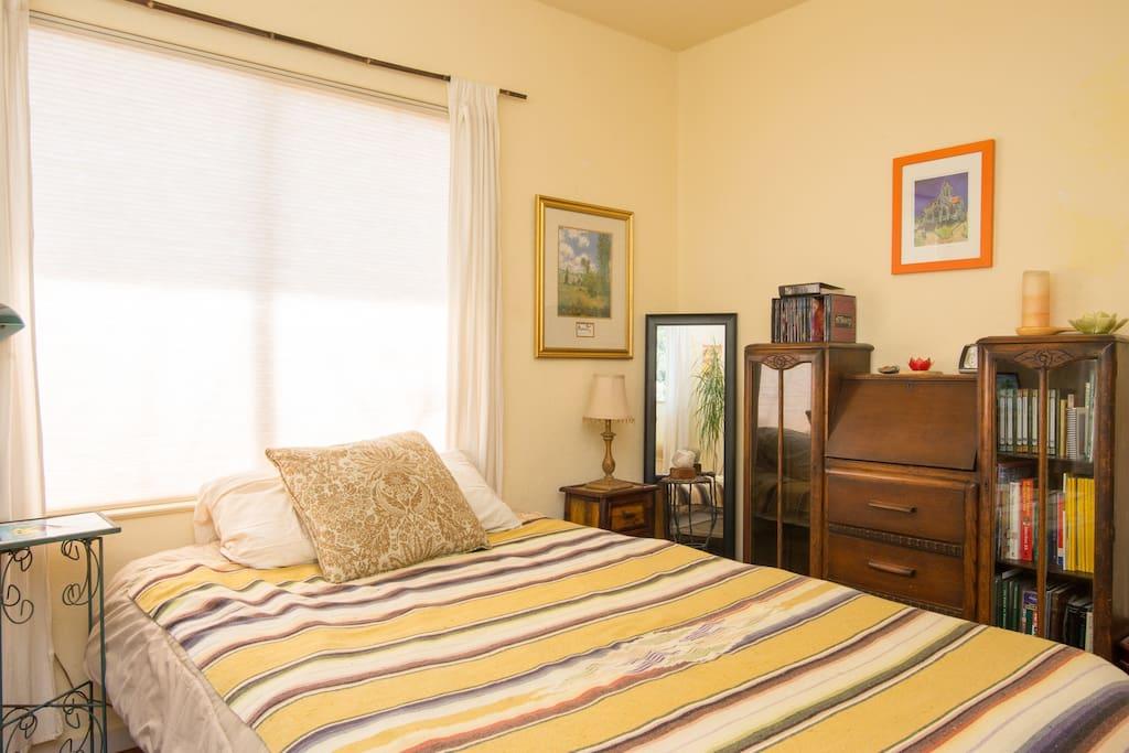 Sunny room w desk and book shelves