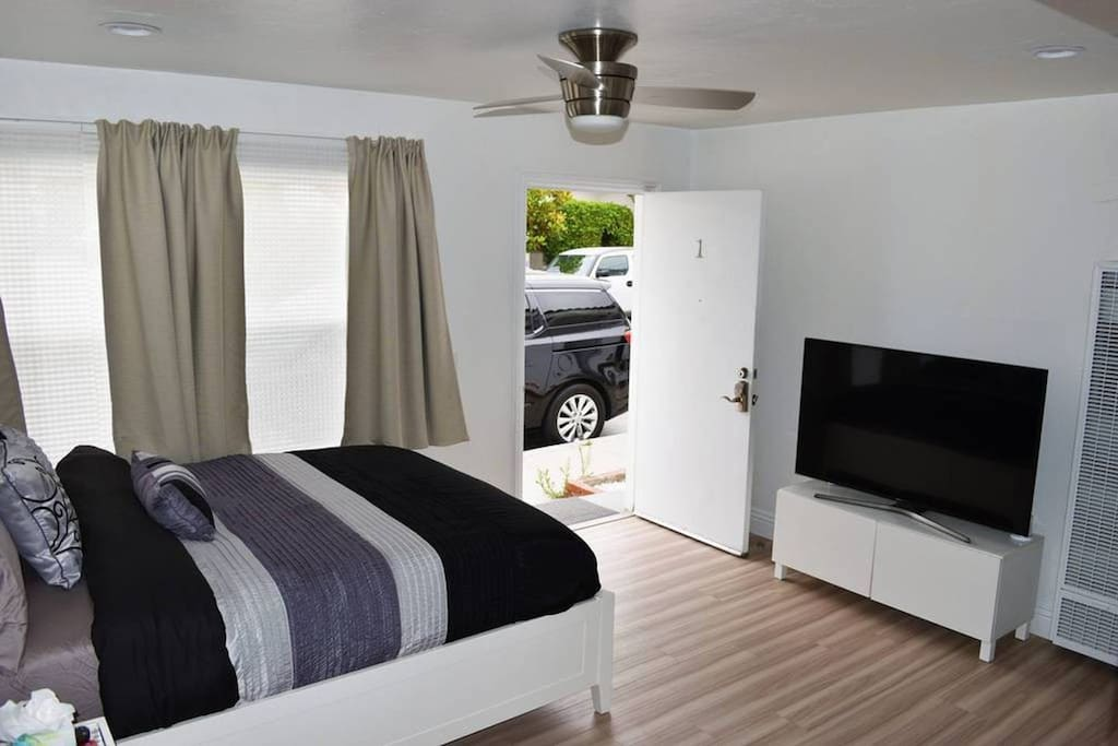 Queen size bed with an LED 55' TV.