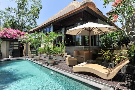 Private villa with 2 bedrooms, ensuite and walk through wardrobes. Mezzanine floor, kitchen, lounge plus garaging, swimming pool, and large rear tropical garden with beautiful views of rice fields and palms.