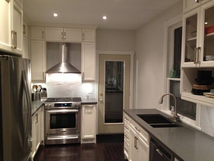 Newly renovated kitchen with all brand new appliances, leading out into backyard patio!