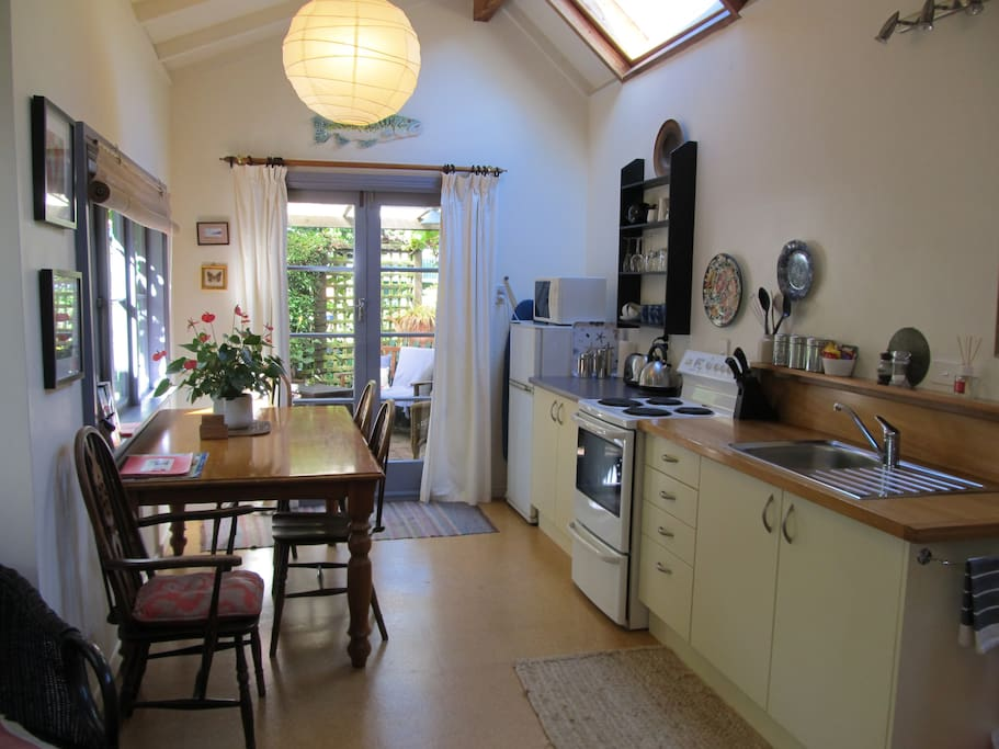 Self catering kitchen. Full oven, frig .. French doors open to covered outside sitting area and garden