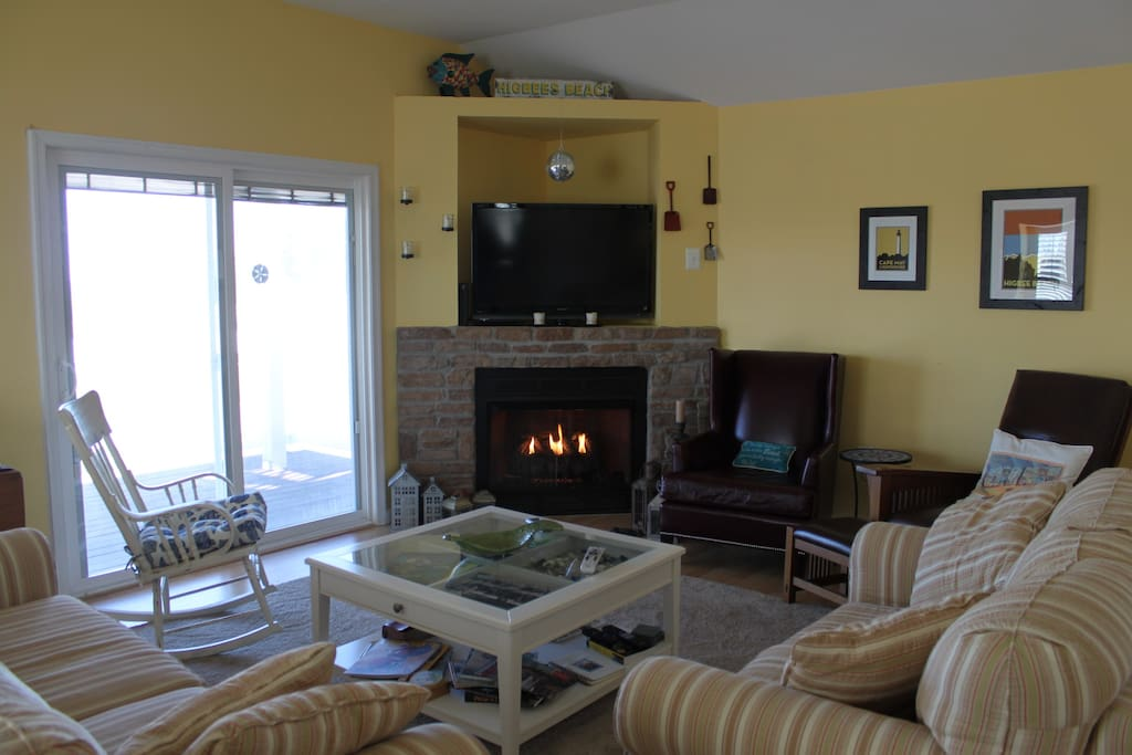 Spacious Living Room with gas fireplace - 2 sliding doors access to decks.