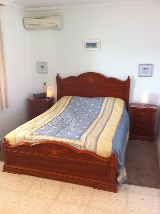 Air conditioned master bedroom with king size bed