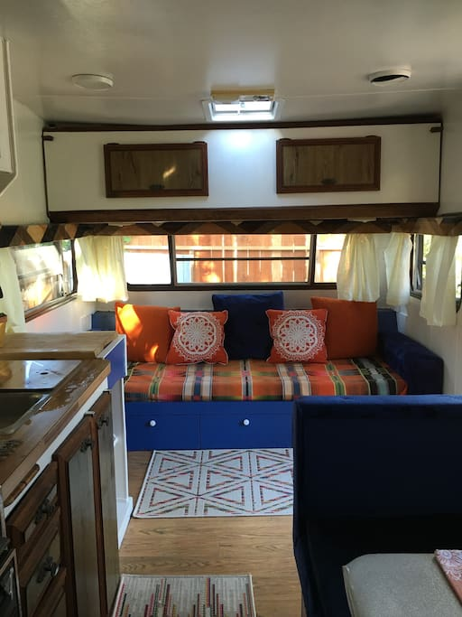 inside the RV, kitchen on the left, and couch at the front (can sleep 1 person or child)