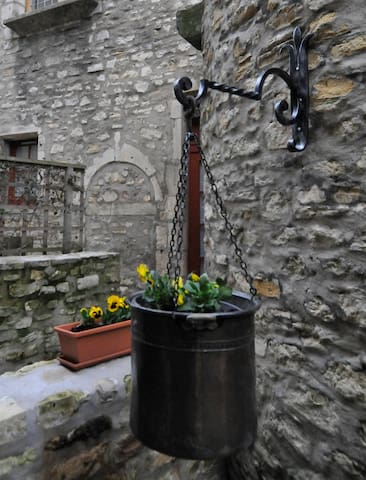 Meneau Suite, spring flowers outside the 15th century stone tower.