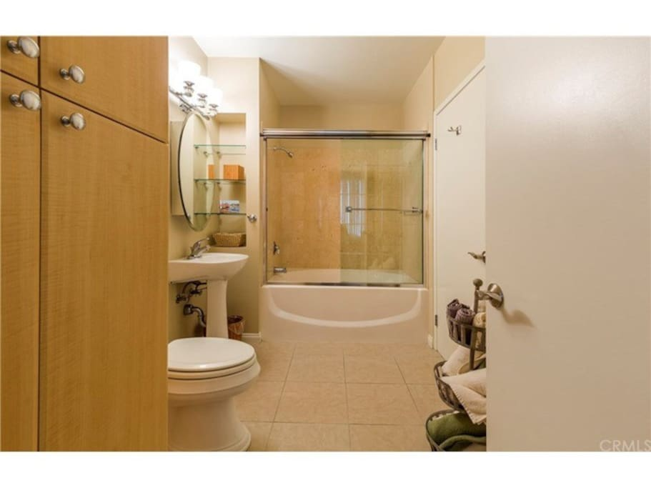 Beautiful updated bathroom with soaker tub directly accesses the bedroom as well as the hallway