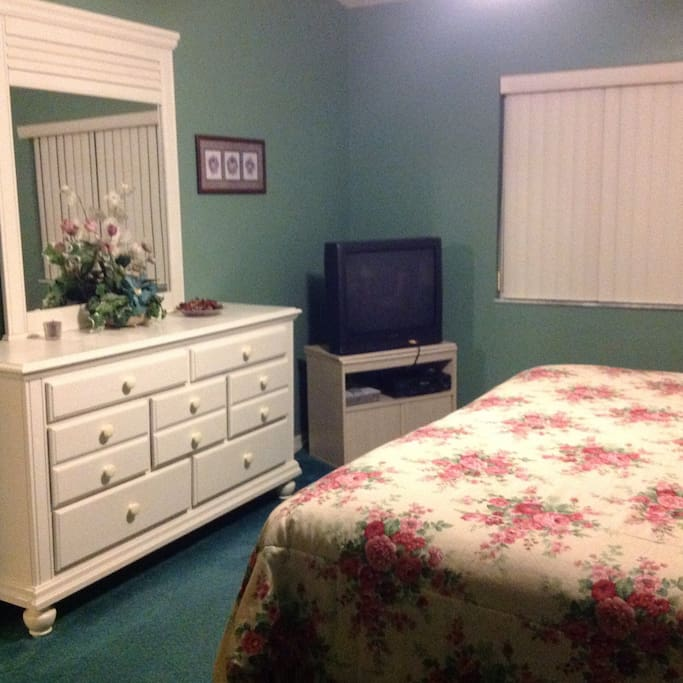 Television and plenty of room for your clothes in Master bedroom