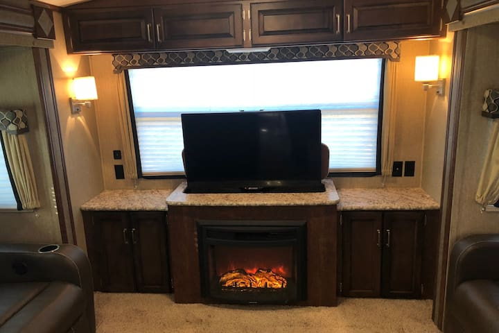 beautiful gas fireplace and television that can be hidden