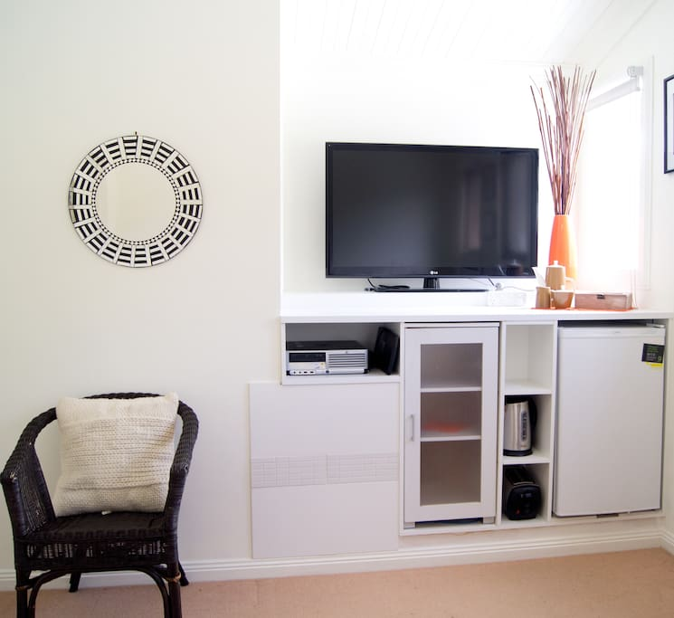 Sitting room with large tv, fridge, toaster and tea making facilities.