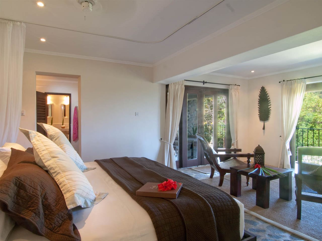 King sized bed, luxury linens and amenities and a private balcony with beautiful views.