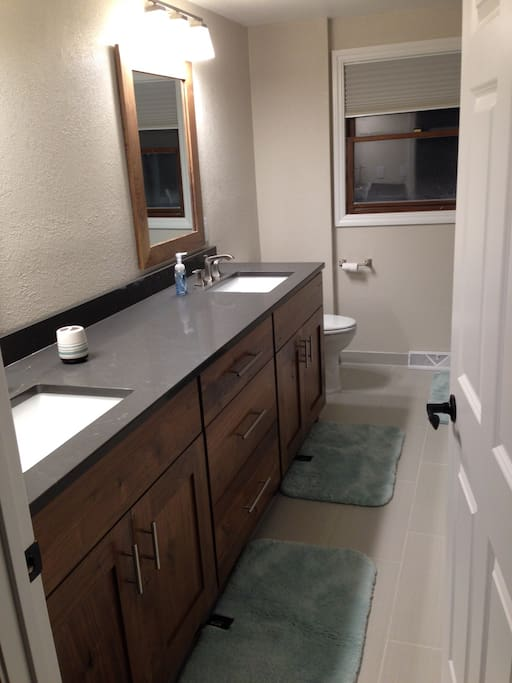 beautiful master suite with double sink vanity