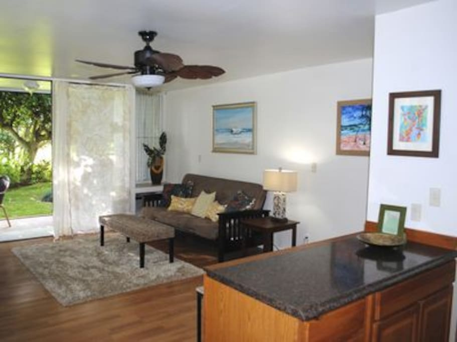 Living room with A/C or ceiling fan & cool breezes from the back lanai