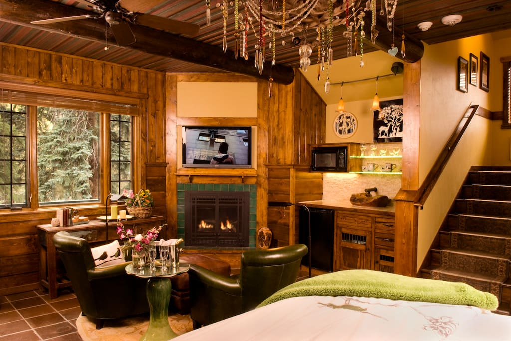 TreeHouse living room. Flat screen TV, fireplace, kitchenette, walk out balcony.