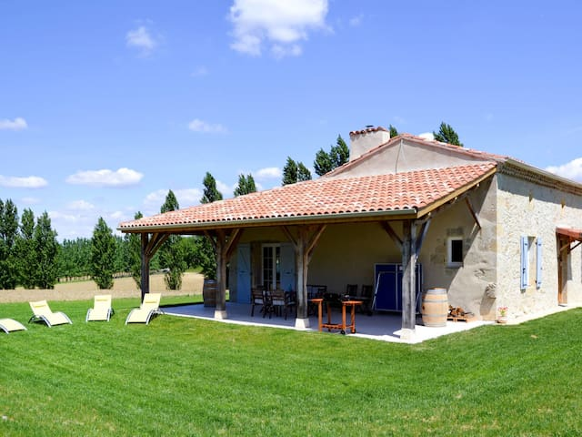 Charming stone house with views of a nearby grove, meadows and fields