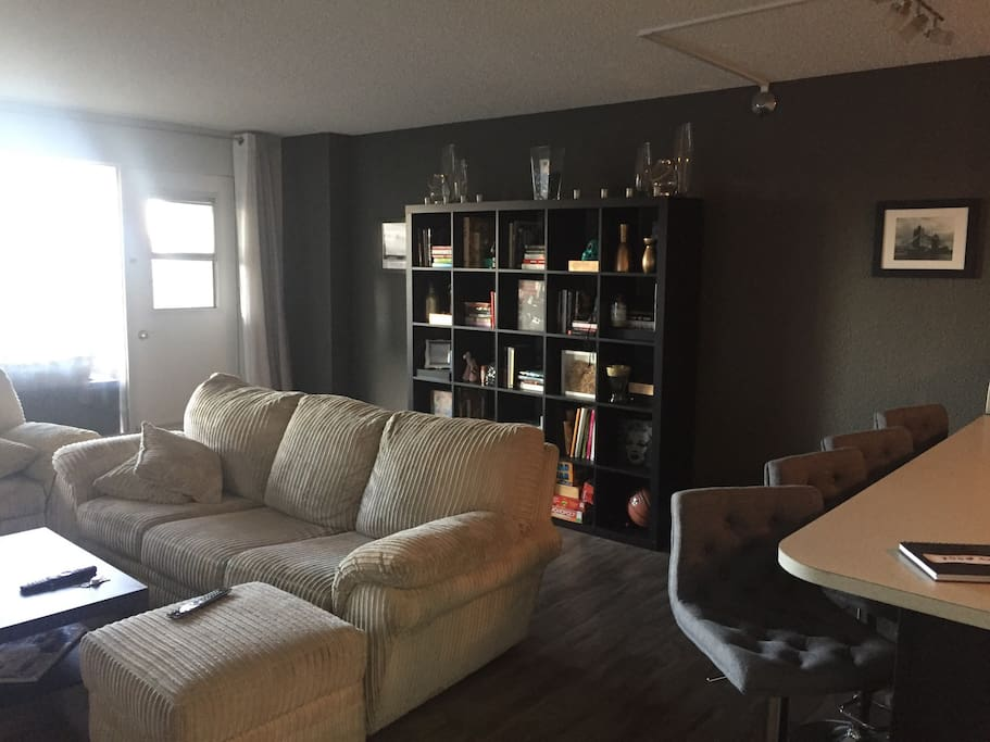 Large bright living room with over sized couch