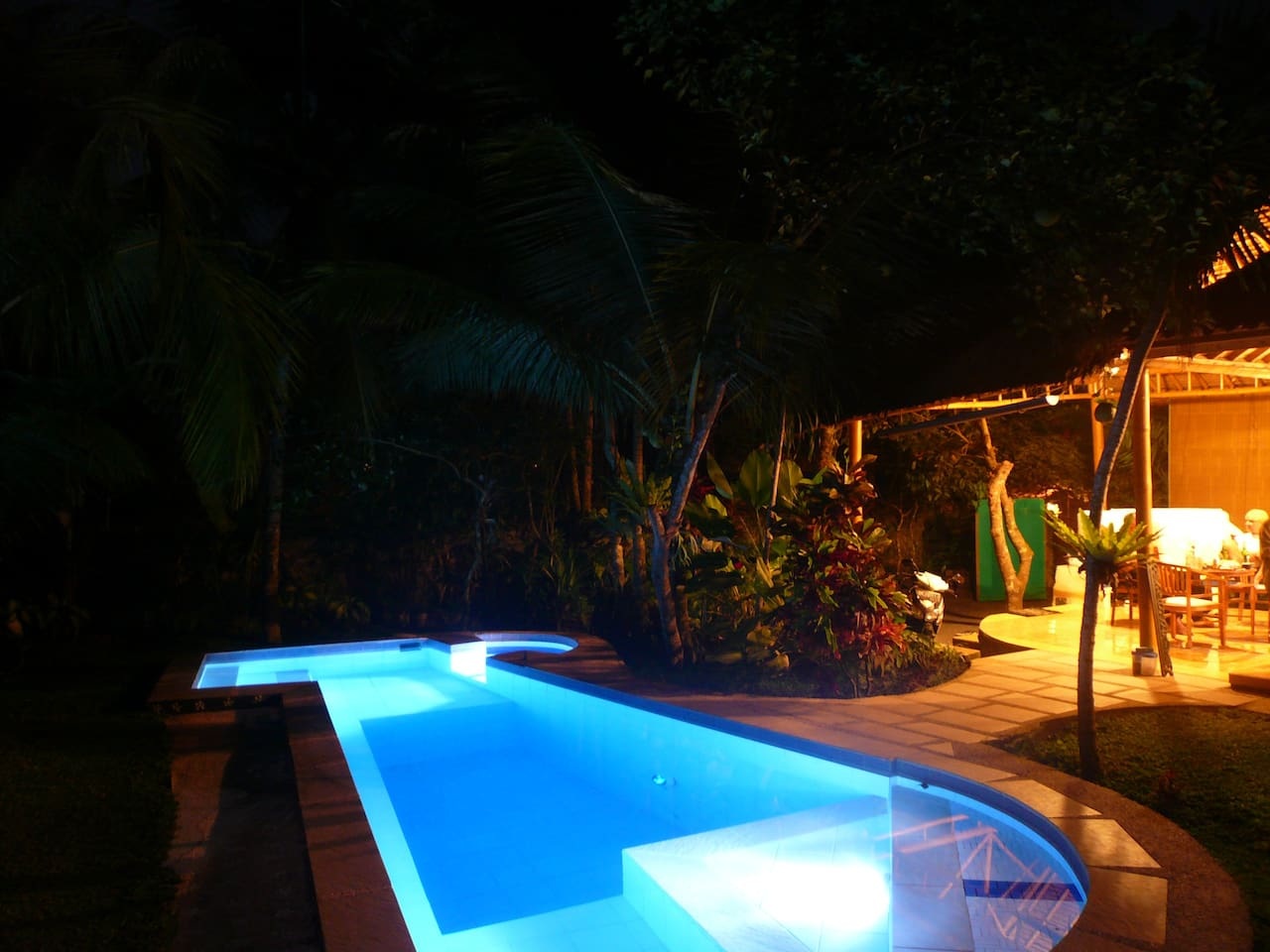 Pool and out door area at night, undercover bike parking for up to 4 bikes