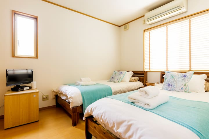 One of our two private bedrooms is decorated in neutral tones with cyan splashes; reminding you of the salty sea breeze when resting.