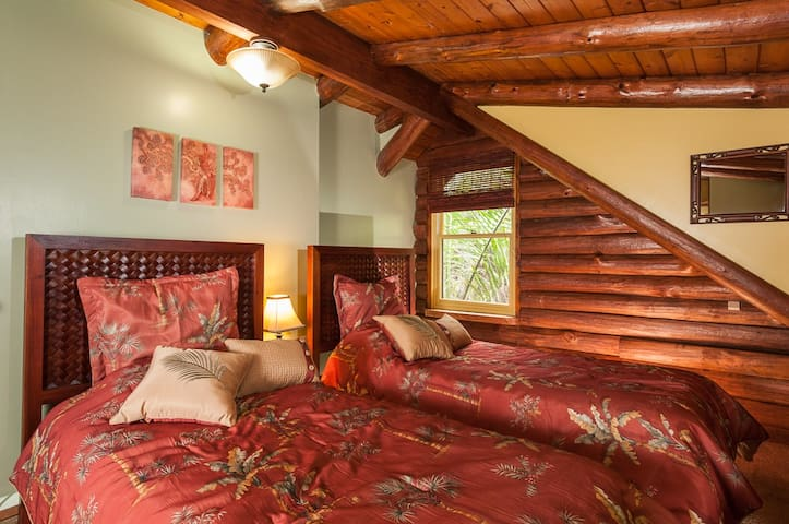 Upstairs bedroom, two twin beds, unique log room, CUTE!