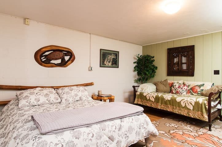 Bedroom on Ground floor with charming elephant bamboo furniture. Queen-size bed and day bed