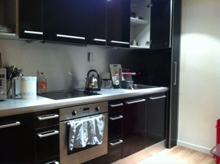 Open plan kitchen / living room, with all amenities.