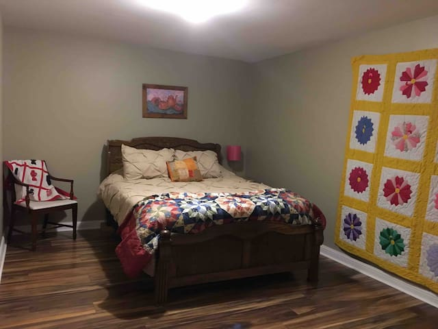 Most guests love this room the best because it has a queen bed with memory foam mattress. The darkening curtains help to block out the world as you drift into the sleep you have needed! You may not hear your alarm!
