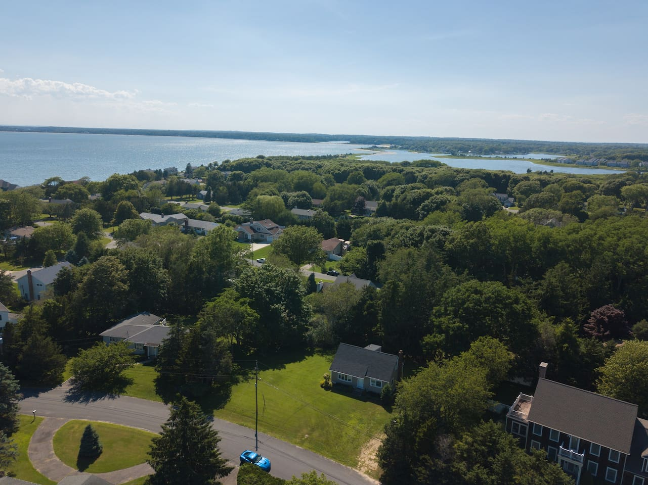 Aerial view of the location of our house, (center foreground), surrounded by the waters of Shelter Bay and just a short walk to our private community sandy beach