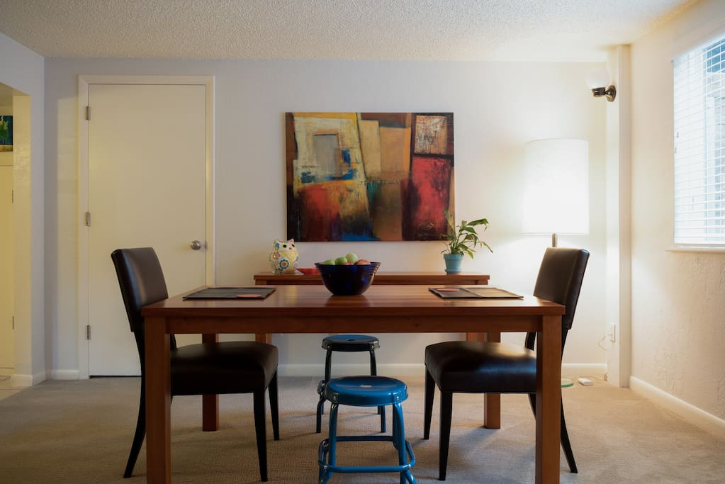 The dining area is located right next to the kitchen and the living area.