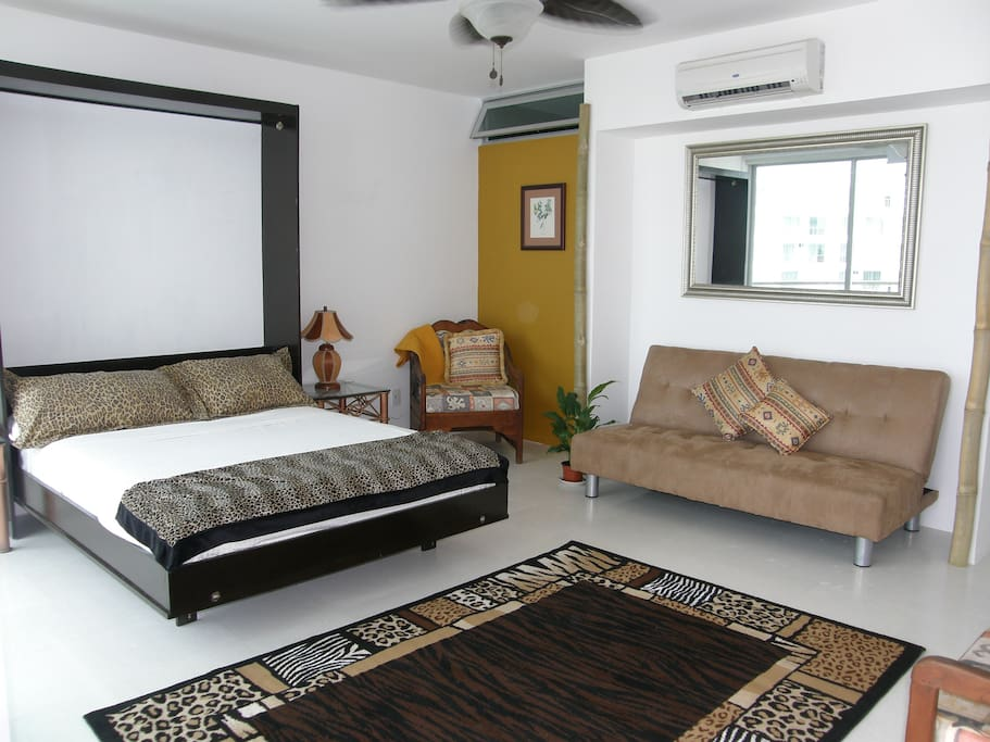 Queen bed in air conditioned living area
