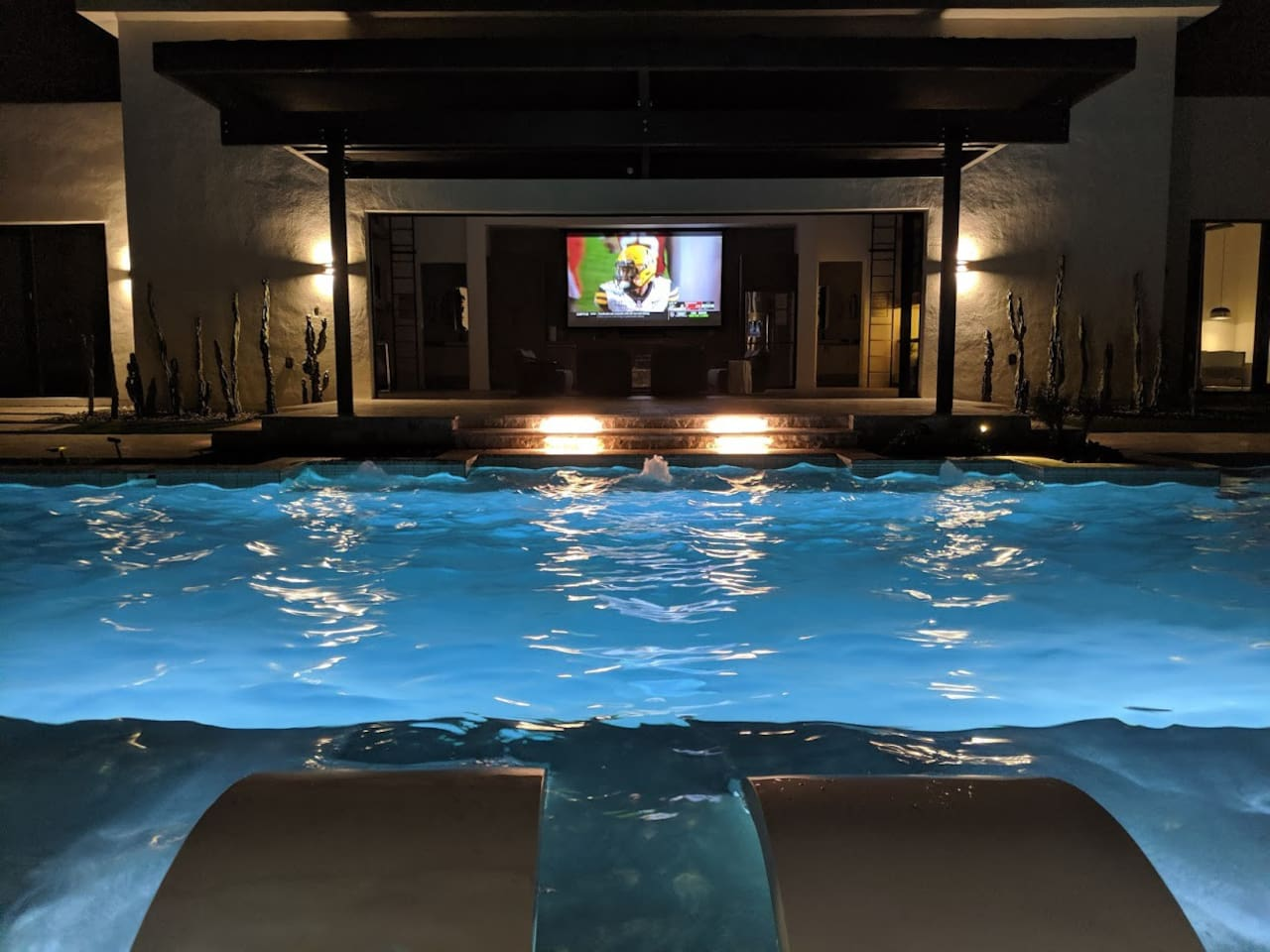 """Watching football on 135"""" TV from the pool"""