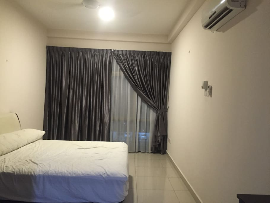Master bedroom with king size bed and air conditioned.