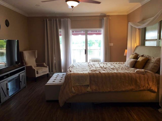 King sized bed in master with ensuite bathroom. Beautiful view of the river and access to the deck.