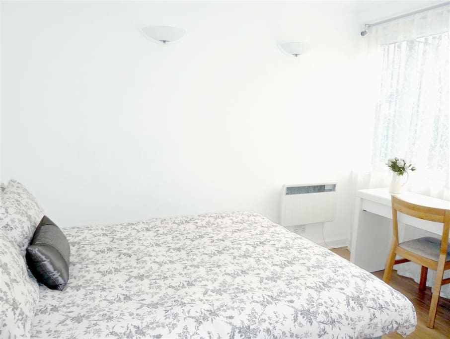 Bedroom: 2 large windows with black out blinds, TV, large fitted wardrobes (out of shot)