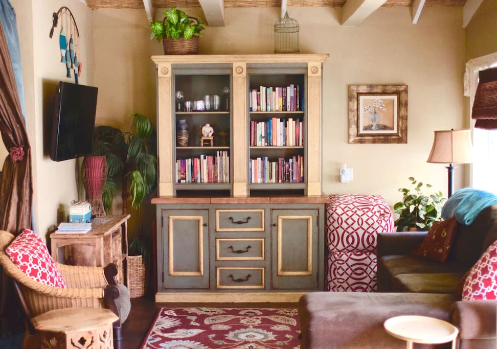 Smart TV, an eclectic assortment of books to peruse. There is a curtain that can be drawn to create two private sleeping areas.