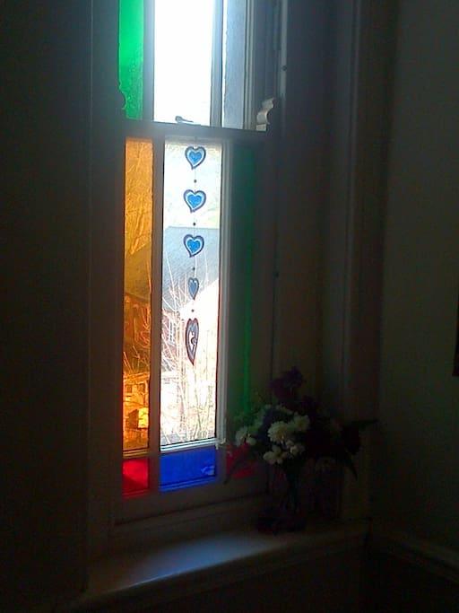 Stained glass windows brighten up our hallways...