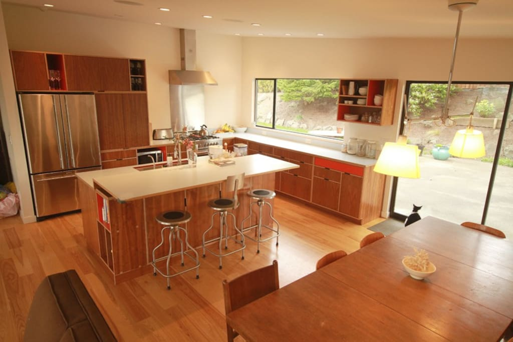 Modern kitchen with stainless appliances, gas stove, and locally-made custom cabinetry.