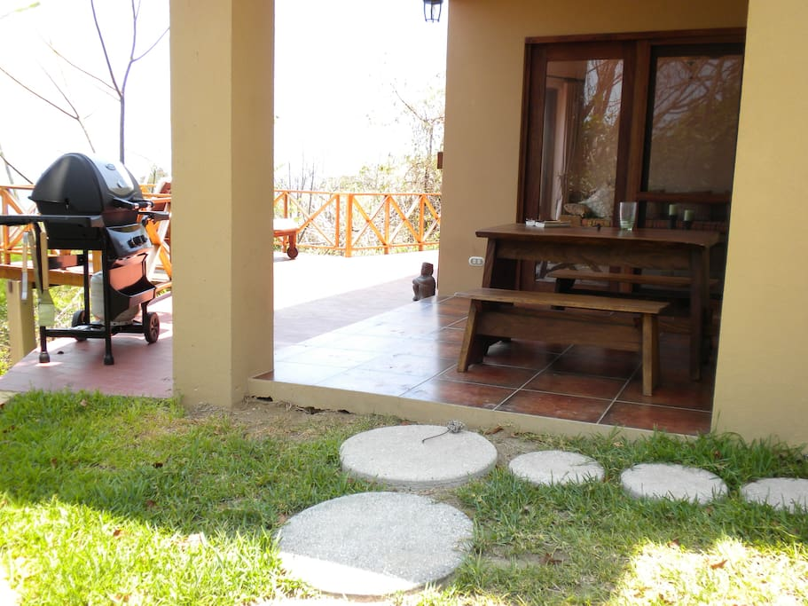 Walk up from the beach and shower outside (to the right), enjoy the BBQ grill and sit in shaded or downstairs terrace