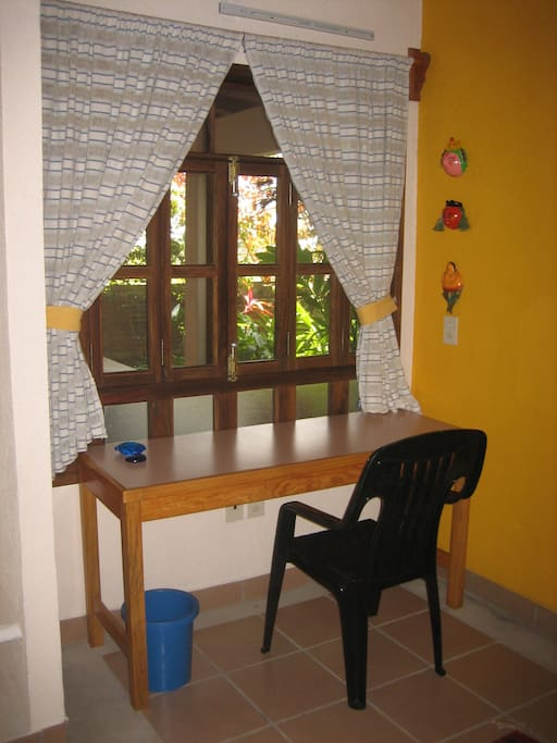 computer table with electrical connection over looking tropical garden