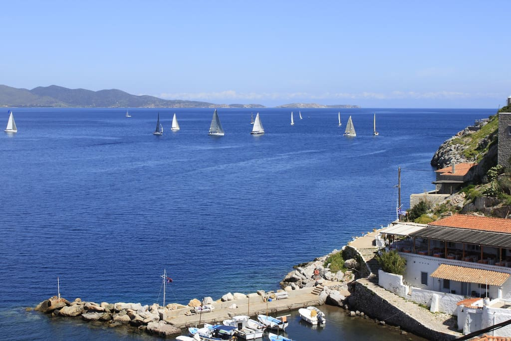 View from Balcony of Sail Boats passing by