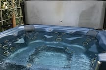 The hot tub is in a covered enclosed area off the solarium.
