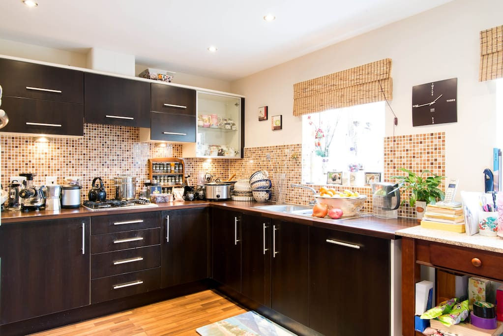 Kitchen w/ double oven, microwave, toaster and kettle