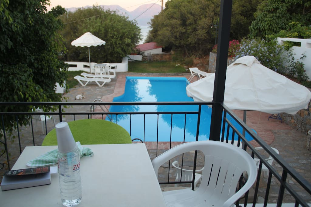balcony from one apartment in Villa Athanati with view to the pool and the sea