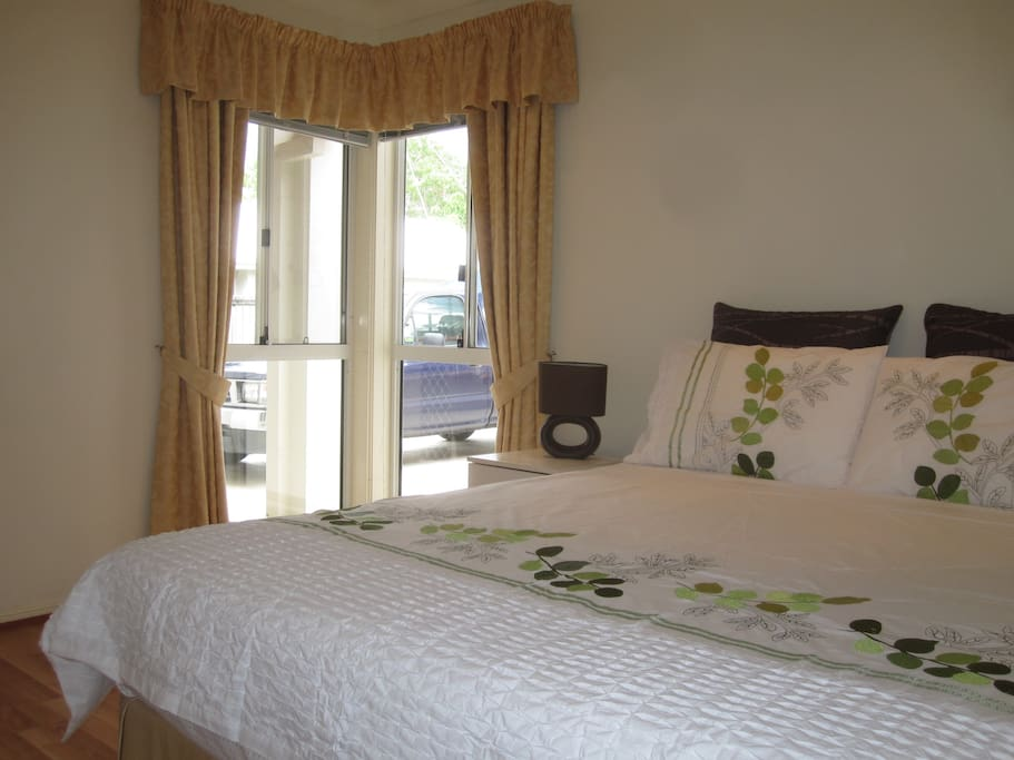 Two private bedrooms each feature a queen bed with fresh linen and towels.