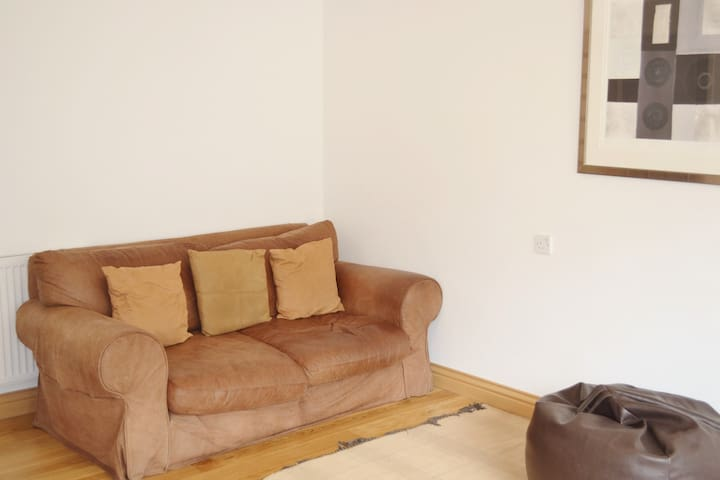 Comfy leather tanned sofas x2 for ample seating space