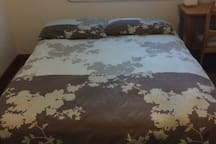 Double bed with two / four pillows