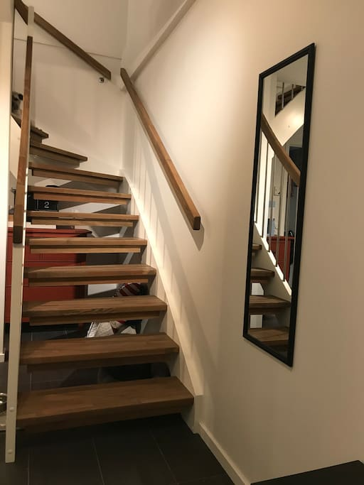 The way up to the 2nd floor where both rooms, guest toilet and the open livingroom/kitchen area is located.